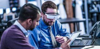 eSight Wearable Legally Blind Low Vision Work Business Professional Working Enhanced Visual Visor Glasses Man Sitting Desk Team