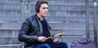 Drumistic Drumming Air Drum Sticks Music Production Midi Smartphone Recording Playing Coach App Man Boy Sitting Stairs Drumming