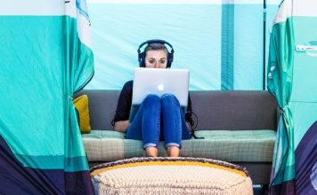 Facebook Birthday Greeting NPO News US Woman Sitting Laptop Working VW Bully Tent crop