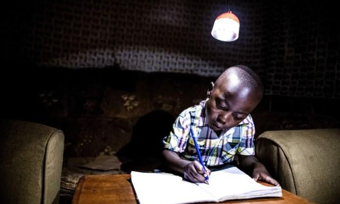 Kenya Child Doing Homework Learning Night Light Kerosene Writing Lamp GravityLight Foundation Innovation Green Tech Clean