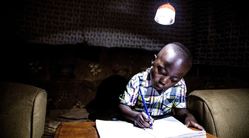 Kenya Child Doing Homework Learning Night Light Kerosene Writing Lamp GravityLight Foundation Innovation Green Tech Clean
