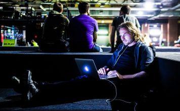 Man Working Website MacBook Laptop Coding Relaxed Listening Music Cozy Lying Legs Up Republica Event Berlin Coder Dev Group Backs Men