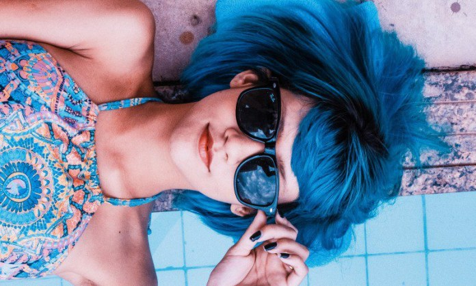 Blue Hair Girl Glasses Shades Ray Ban Lying Pool Relaxed Pretty Holidays Competition Rivalry Feature Article