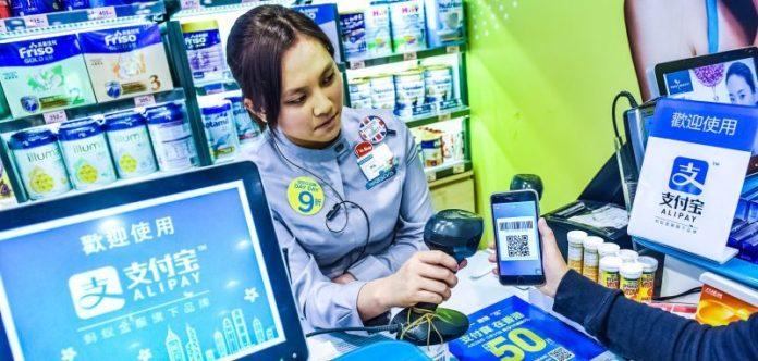 Ant Financial Logo Wall Office China Alipay Record Series C Funding VC News 14 Billion News Woman Hongkong Cashier Taking Payment Smartphone App