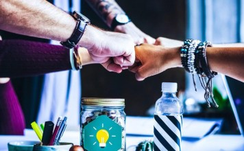 Fist bump collaboration team work startup working together dot tech domain names tld how to choose website name tips hints guide good branding marketing
