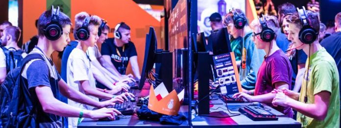 Gaming Addiction Is Now Recognized by the WHO Amazon Booth Gamescom Marcus Verch