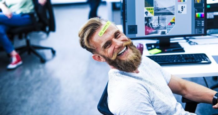 Designer Man With Beard Smiling Laughing Happy Working Content Management System CMS Small Medium Business Enterprise Development