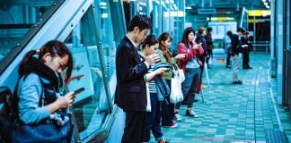 Smartphone Users Japan Tokyo Android iPhone Devices Phones Waiting For Train Group People Subway Metro JR