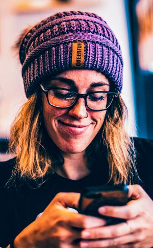 Woman Person Using Smartphone Feeling Shy Texting Emotion Smiling Beanie