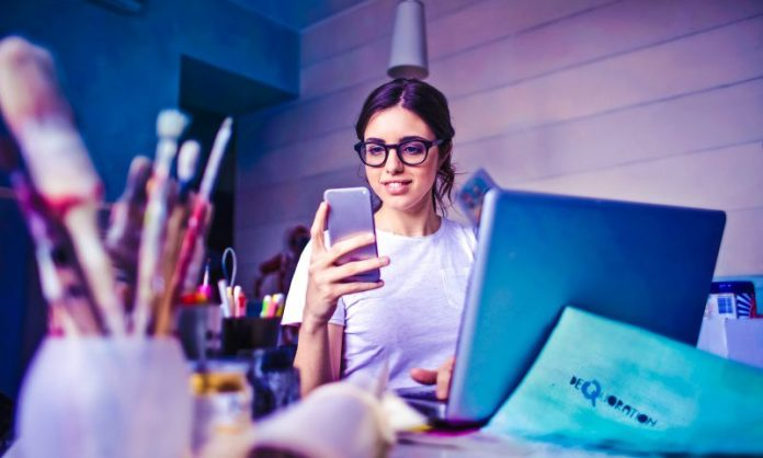 Woman working on desk creative design business entrepreneur female founders tech startup girl power