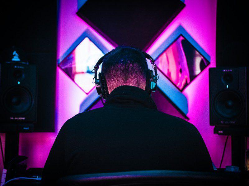 Audiotools online browser music production lanes loops sampling tracks programming virtual instruments free community producing art creative man listens headphones monitor studio