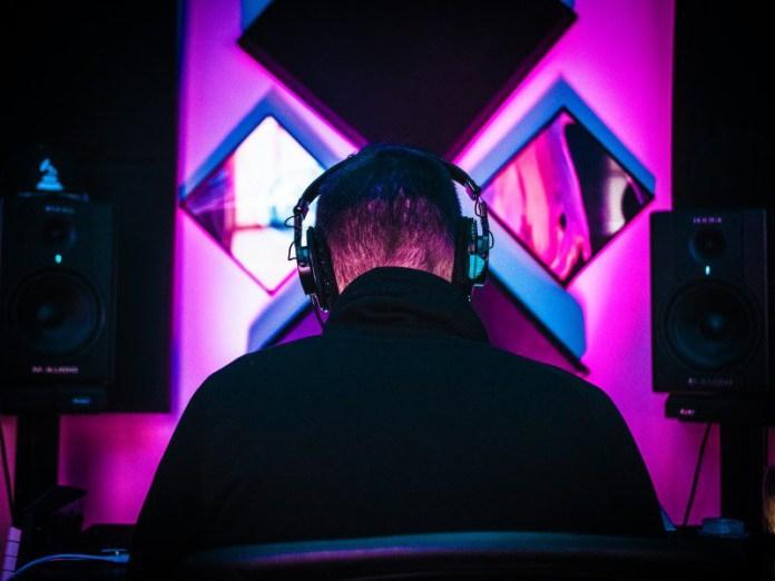 Audiotools-Online-Browser-Music-Production-Lanes-Loops-Sampling-Tracks-Programming-Virtual-Instruments-Free-Community-Producing-Art-Creative-Man-Listens-Headphones-Monitor-Studio