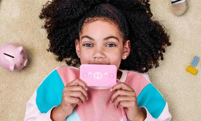 Pigzbe Digital Wallet Cryptocurrency Education EdTech Spending Finance Young Girl Holding Gadget