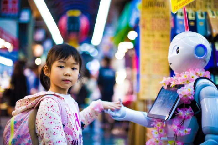 Young Child Holding Hands With Robot EmoShape Chip Tech Emotion Sympathy AI Gaming Robotics IoT