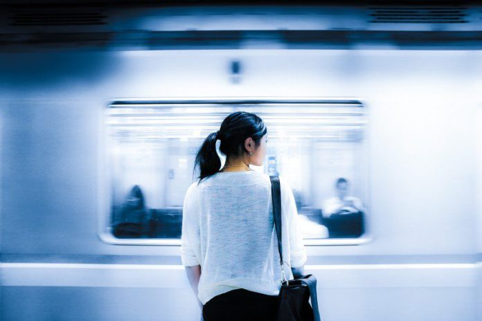 Woman Waiting For Train Looking From Behind City Travel Uncertain Direction