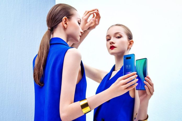 Nubia Z20 Double Display Front Rear Screen New Innovation Smartphone Market Tech News Woman Holding Phone Mirror Model