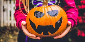 Tech for Halloween Pumpkin Held By Child Spoopy Gadgets