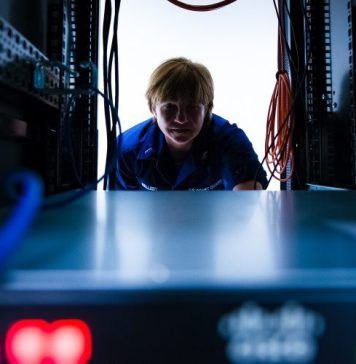 Cisco Stealthwatch Cloud A New Age of Cyber Security Female Technician IT Checking Server Rack