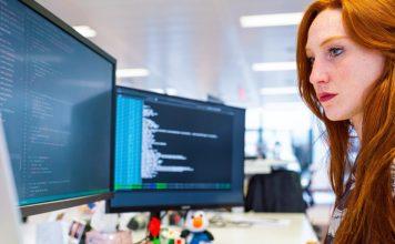 15 Tips from Pro Developers for Programming Beginners Female Coder On Desk