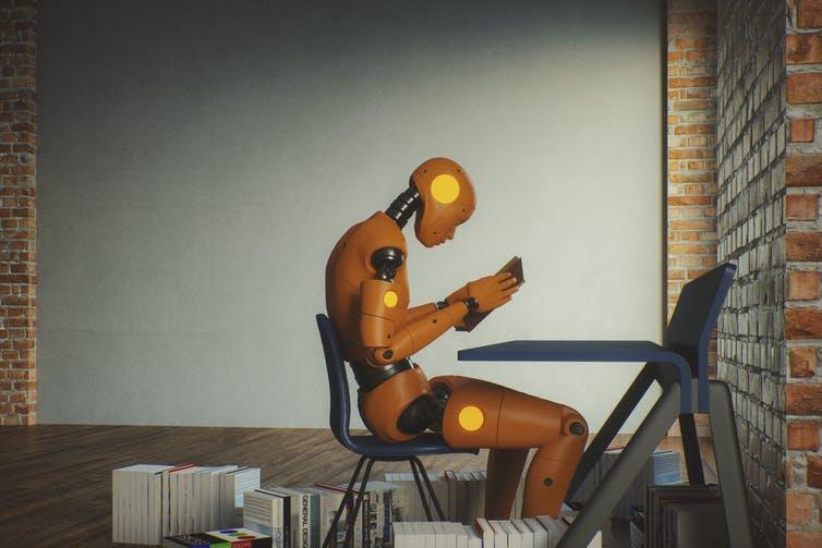 A humanoid robot reading a book.