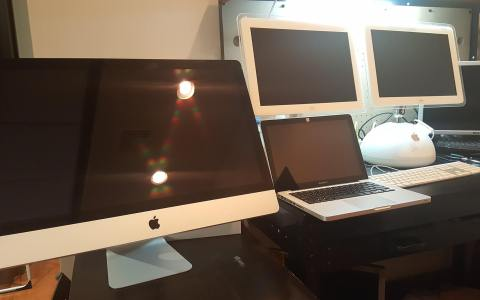picture of several apple computers including an imac and macbook pro which tech corner is performing their repair service on