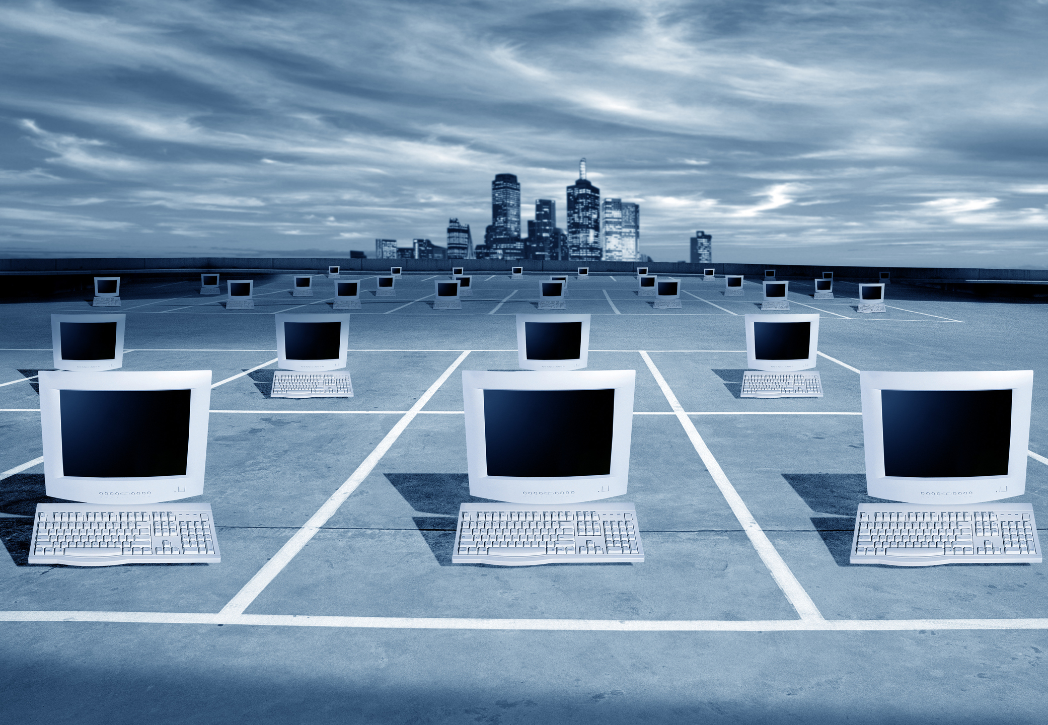 Computers on the network in front of the city skyline.