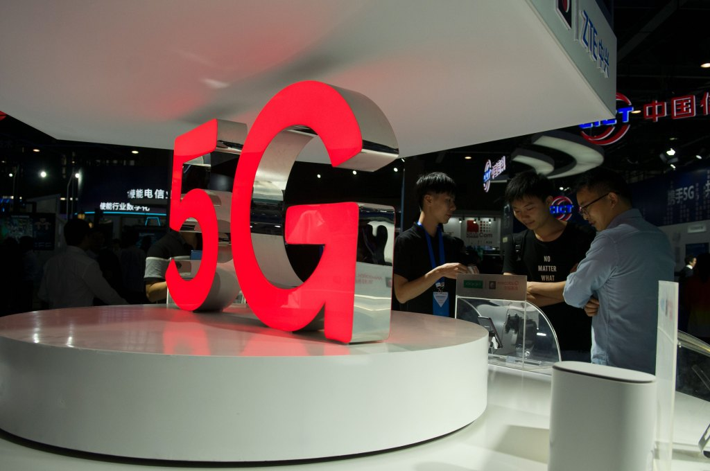 Attendees are looking at the 5G mobile phones at the Qualcomm Pavilion during the 2018 China Mobile World Partner Conference at the Poly International Trade Show Hall on December 6, 2018 in Guangzhou, Guangdong Province.