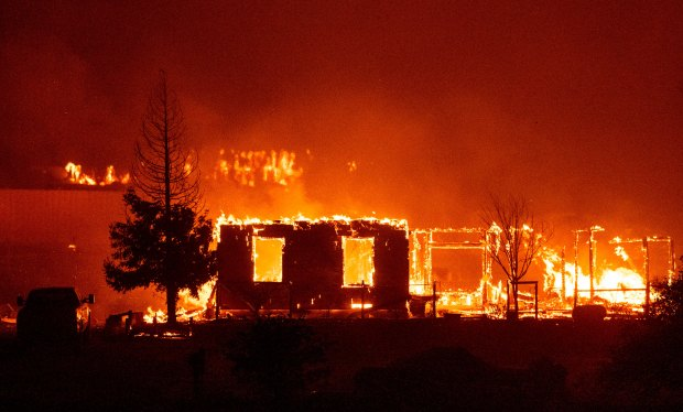 Homes are engulfed in flames in Vacaville, California during the LNU Lightning Complex fire on August 19, 2020.