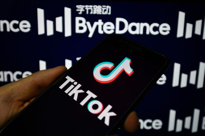 In this photo illustration a TikTok logo is seen displayed on a smartphone with a ByteDance logo on the background. (Photo Illustration by SheldonCooper/SOPA Images/LightRocket via Getty Images)