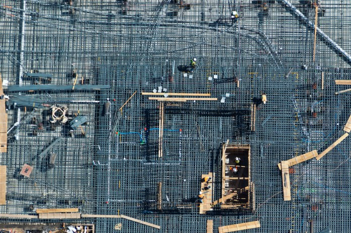 Rebar is laid before poring a cement slab for an apartment in San Francisco CA.