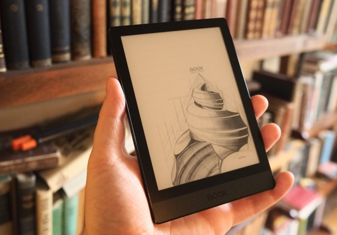 A Boox Poke 3 e-reader in a hand.