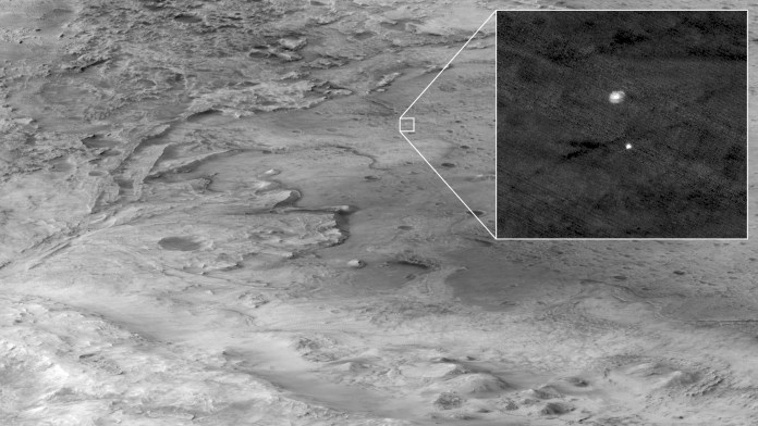Photo taken from 700km away by the Mars reconnaissance Orbiter of the Perseverance rover descending under its parachute.