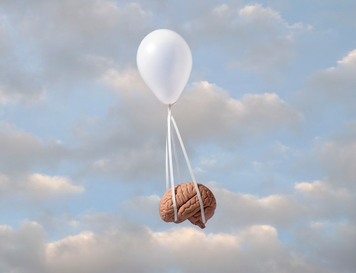 Image of a balloon carrying away a brain.