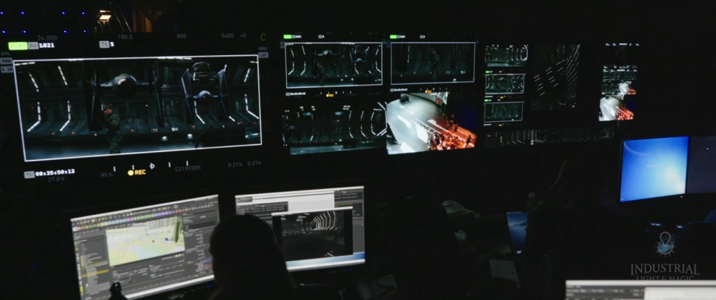 Producers look at a bank of screens with images from the set of The Mandalorian on them.
