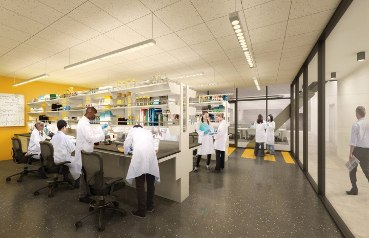 Students in a lab space working in white coats.