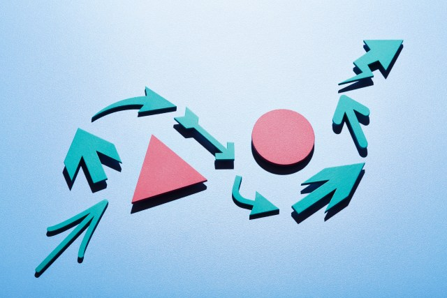 Image of a group of arrows moving up and around obstacles.