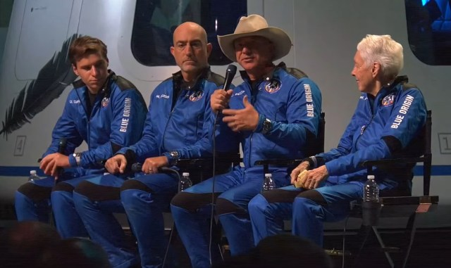 Jeff Bezos speaks into a mic at the blue origin press conference.
