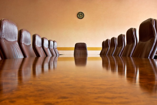 Meeting room with a big polished table and arm-chairsOther photos from this business series: