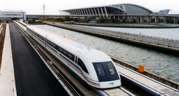 http---upload.wikimedia.org-wikipedia-commons-d-d1-A_maglev_train_coming_out,_Pudong_International_Airport,_Shanghai