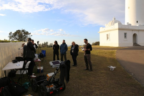 team from Macquarie preparing equipment in front of the Macquarie lighthouse