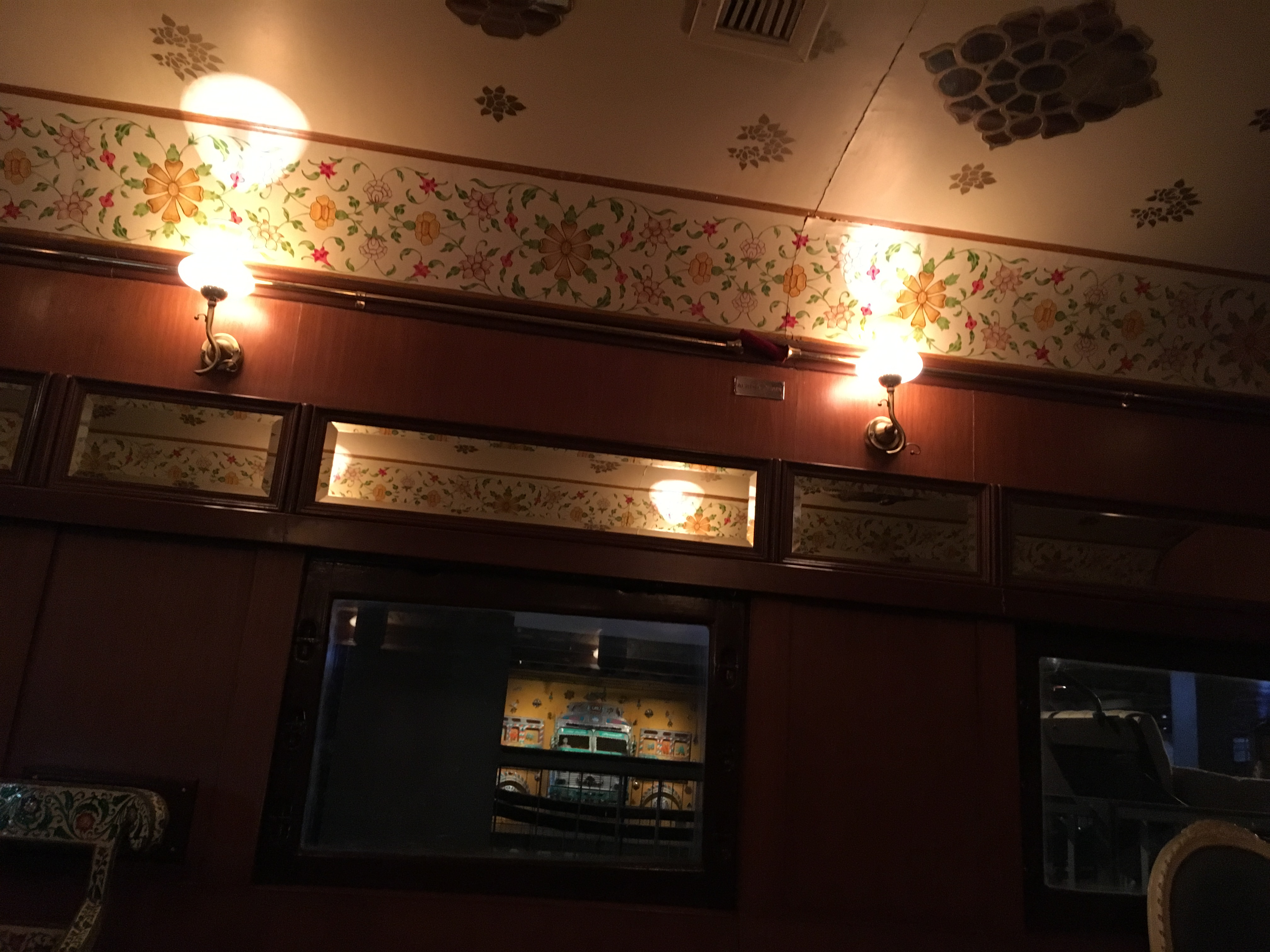 Decorated ceiling with two show lights and intricate wall border