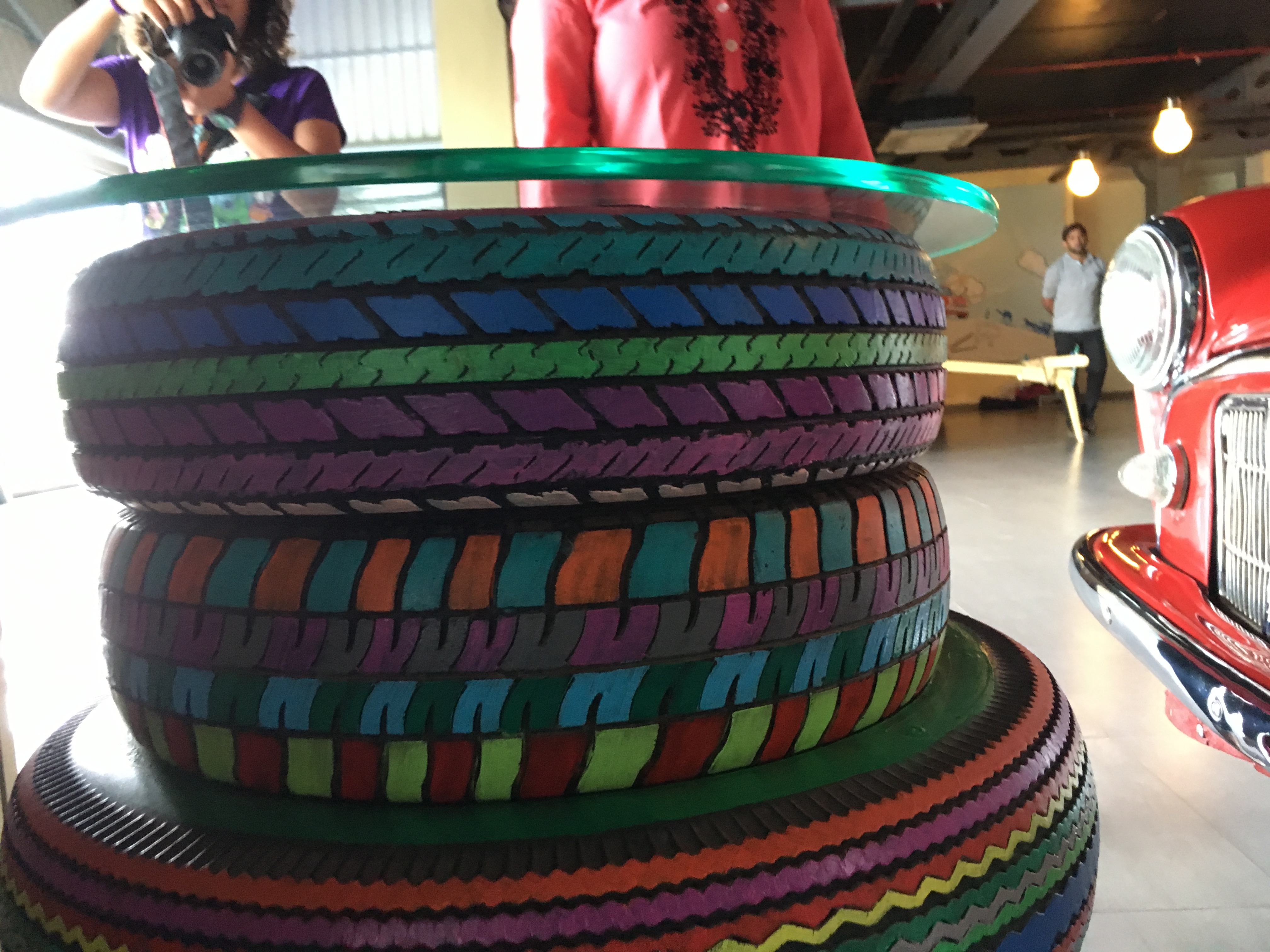 A stack of rainbow coloured tyres