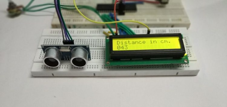 Image shows interfacing of Ultrasonic sensor with pic microcontroller.