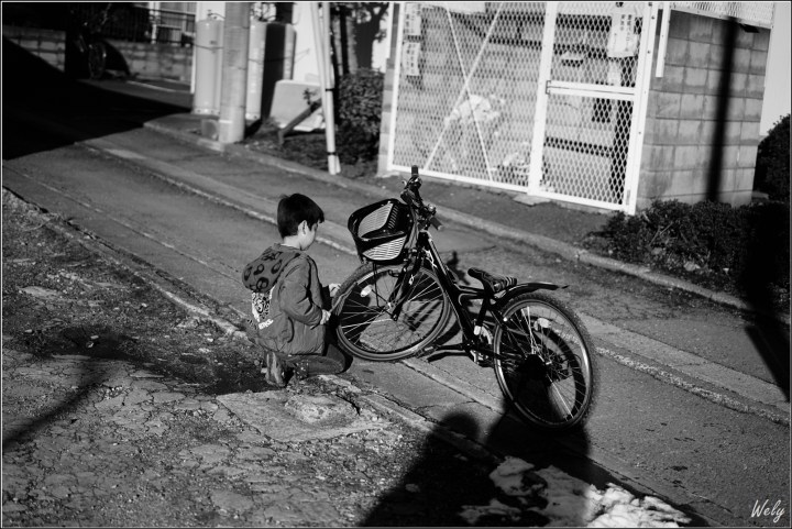 The black and white photo of the boy with the bicycle made on Sony a7