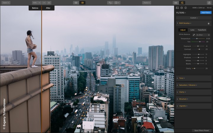 A picture of a girl standing on the tall building in the city. It's being processed in Luminar 2018 and the interface is seen