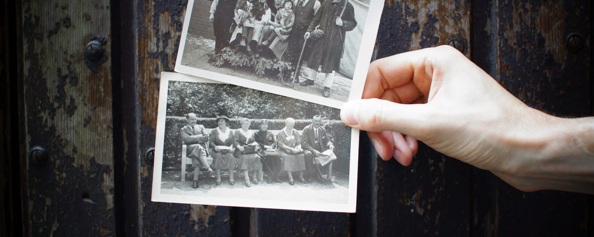 a person holding two photos for a slideshow