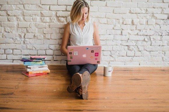 girl writing on laptop