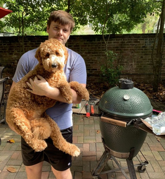 photo of Cody and Dexter in front of the Green Egg grill