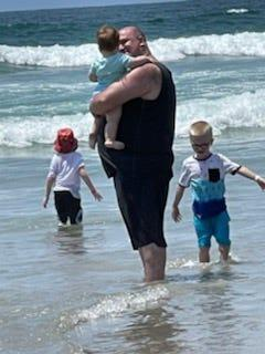 Freedy and three of his five children spend time at the beach during a trip to San Diego, California.