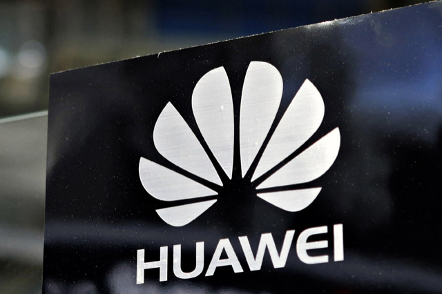 File photo of a Huawei logo seen above the company's pavilion during the CommunicAsia trade show in Singapore